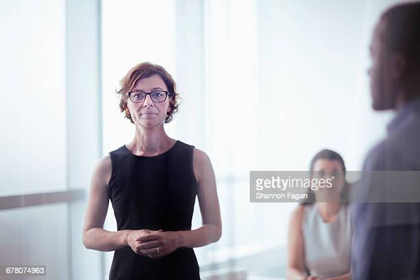 Portrait of businesswoman with office colleague
