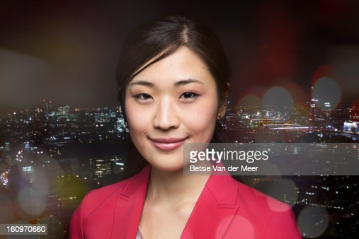 Portrait of businesswoman,city in background. : Stock Photo
