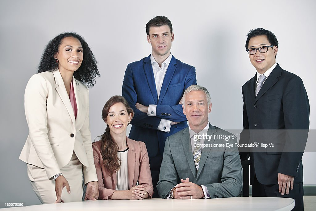 Portrait of busness people around table : Stock Photo