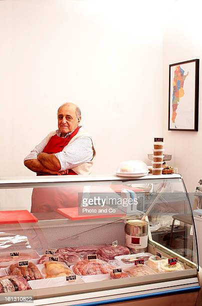 portrait of butcher on his shop