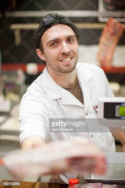 Portrait of butcher wearing hairnet