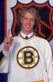 Portrait of Canadian ice hockey player Joe Thornton in the jersey of the Boston Bruins following his first round first place selection in the NHL...