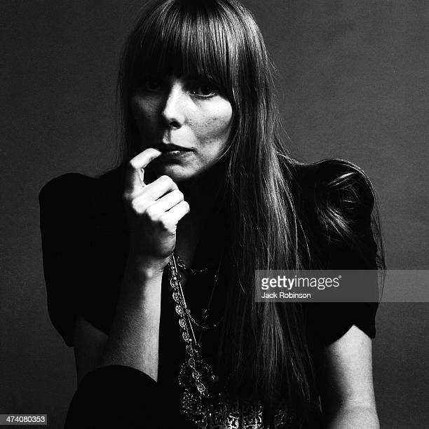 Portrait of Canadian musician Joni Mitchell wearing a black shortsleeved dress with several necklaces November 1968 This image was from a photo shoot...