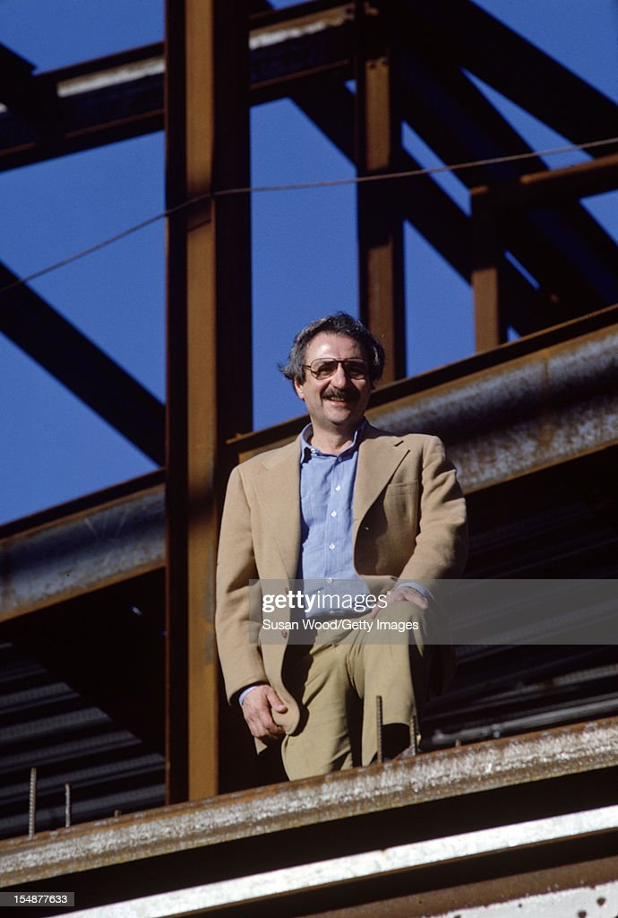 Portrait of CanadianAmerican architect Frank Gehry as he stands amid steel Ibeams at the construction site of one of his buildings California January...