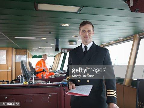 Portrait of captain on bridge of ship