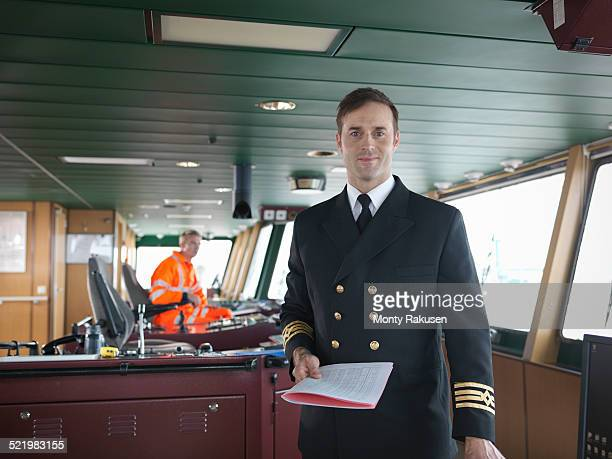 Portrait of captain on bridge of ship