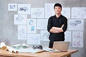 Portrait of car designer in studio