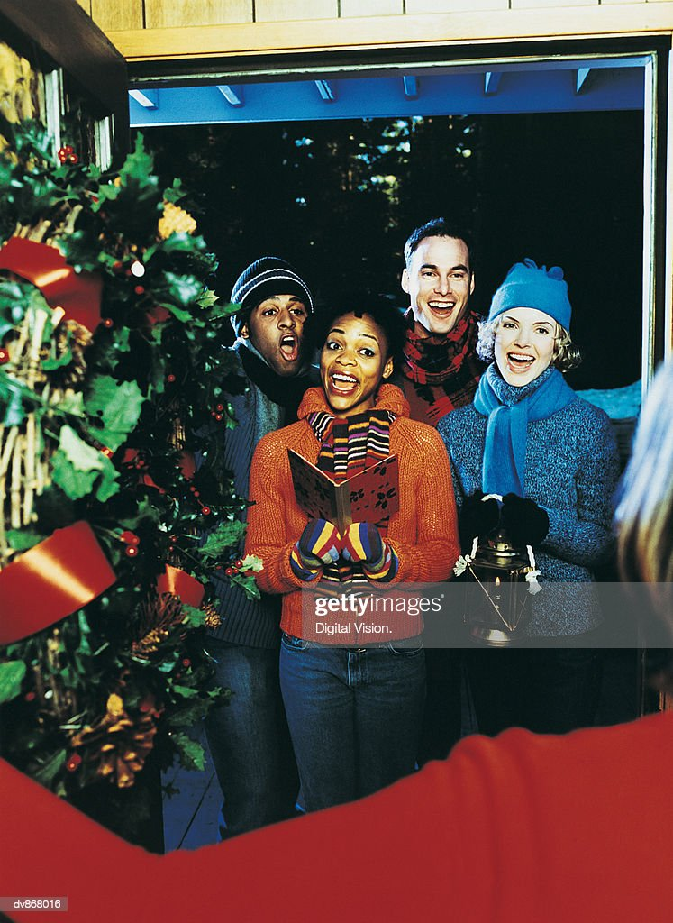 Portrait of Carol Singers Standing at the Door at Christmas