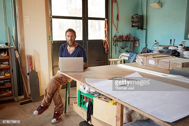 Portrait of carpenter in wood workshop