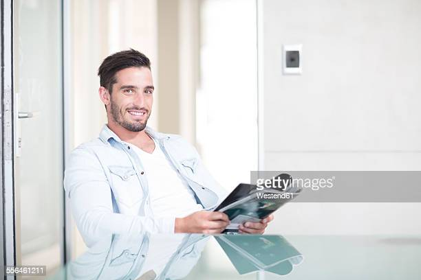 Portrait of casually dressed man in office