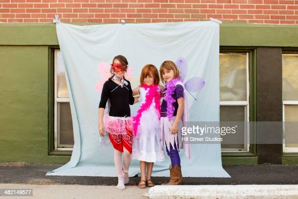 Portrait of Caucasian girls in costumes outdoors