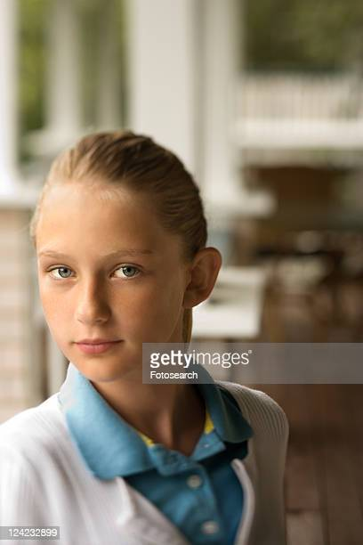 Portrait of Caucasian pre-teen girl looking at viewer.
