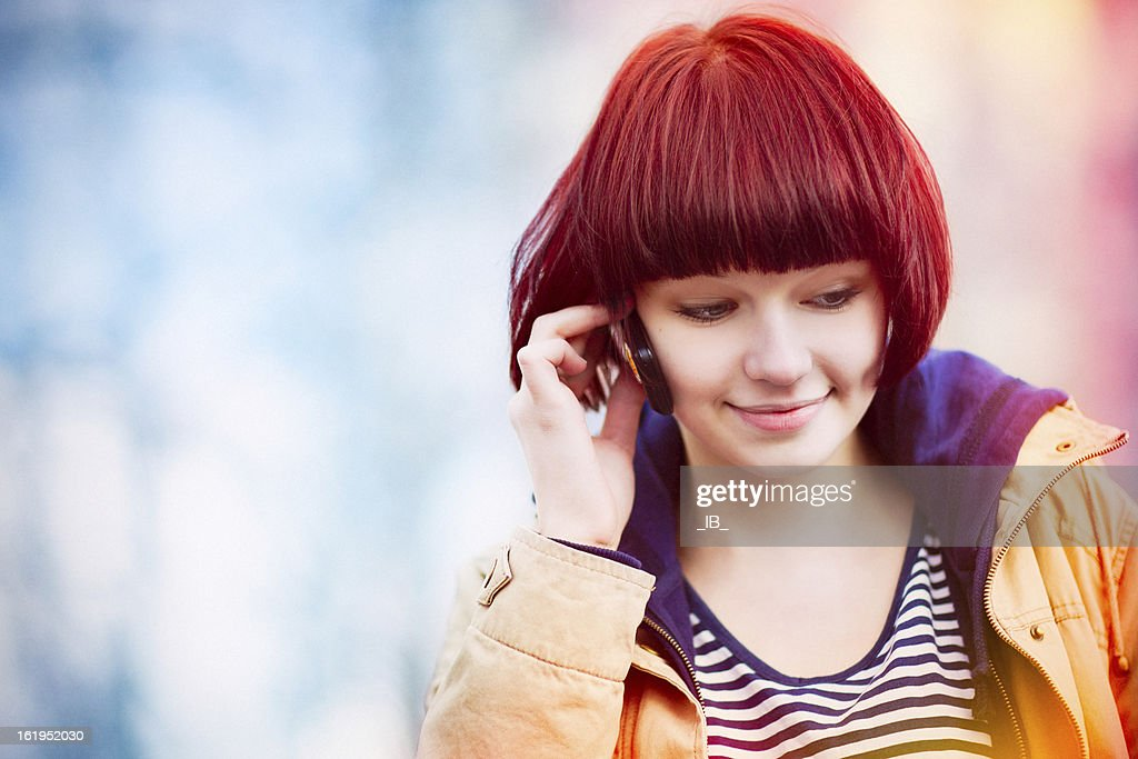 Portrait of charming girl talking on the phone