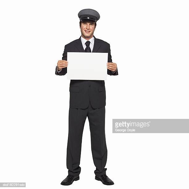 Portrait of chauffeur holding blank card