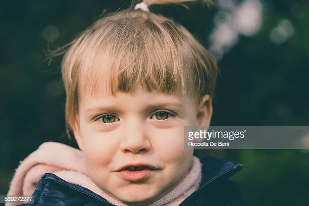 Portrait Of Cheerful Little Girl Having Fun In The Nature
