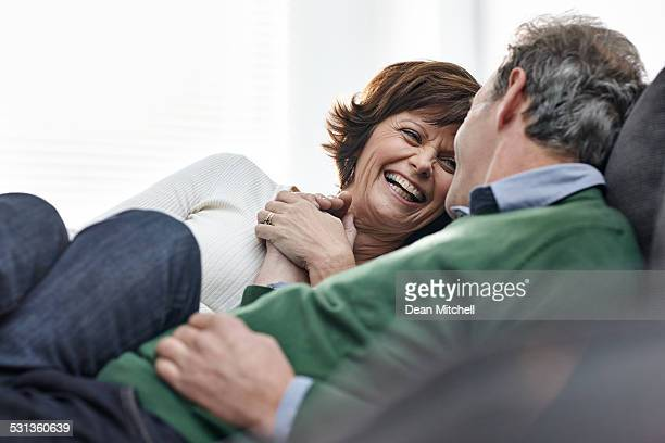 Portrait of cheerful mature couple - Indoors