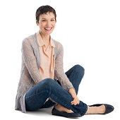 Portrait of cheerful mature woman sitting isolated over white background