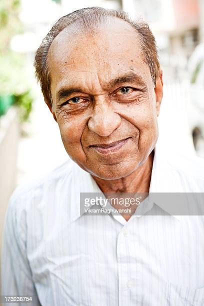 Portrait of Cheerful Middle Class Indian Senior Man