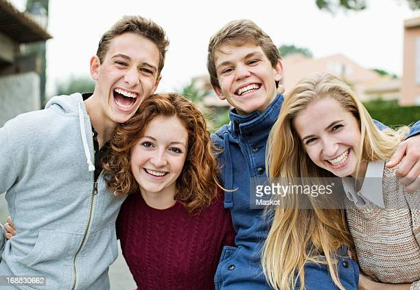 Portrait of cheerful young friends standing together