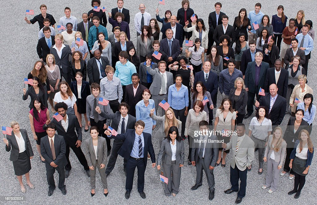 Portrait of cheering crowd of business people : Stock Photo