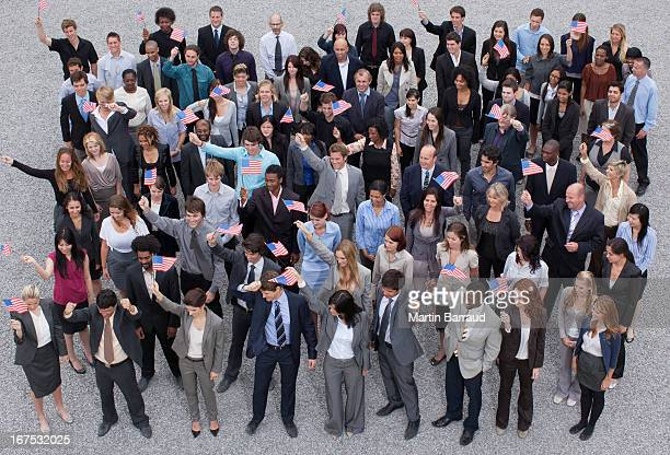 Portrait of cheering crowd of business people