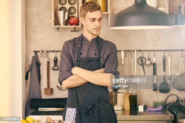Portrait of chef, arms crossed, looking away