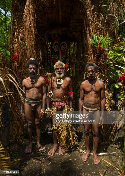 Portrait of chieftain Etul and his sons in front of the nakamal Ambrym island Fanla Vanuatu on August 29 2007 in Fanla Vanuatu