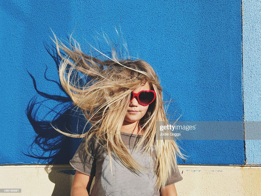 Portrait of child with hair blowing in the wind
