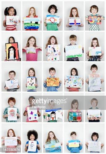 Portrait of children holding their art work