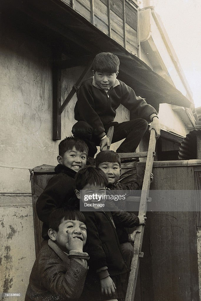 Portrait of children standing at the backyard : Stock Photo