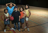 Portrait of children standing together on a basketball court