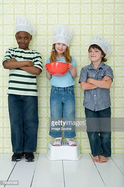 Portrait of children wearing chef hats