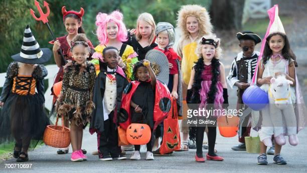Portrait of children wearing costumes on Halloween