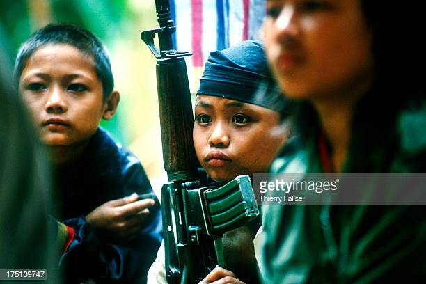 Portrait of childsoldiers in Kamerplaw southern Burma headquarters of God's Army a ragtag breakaway guerrilla faction of the Christian Karen National...
