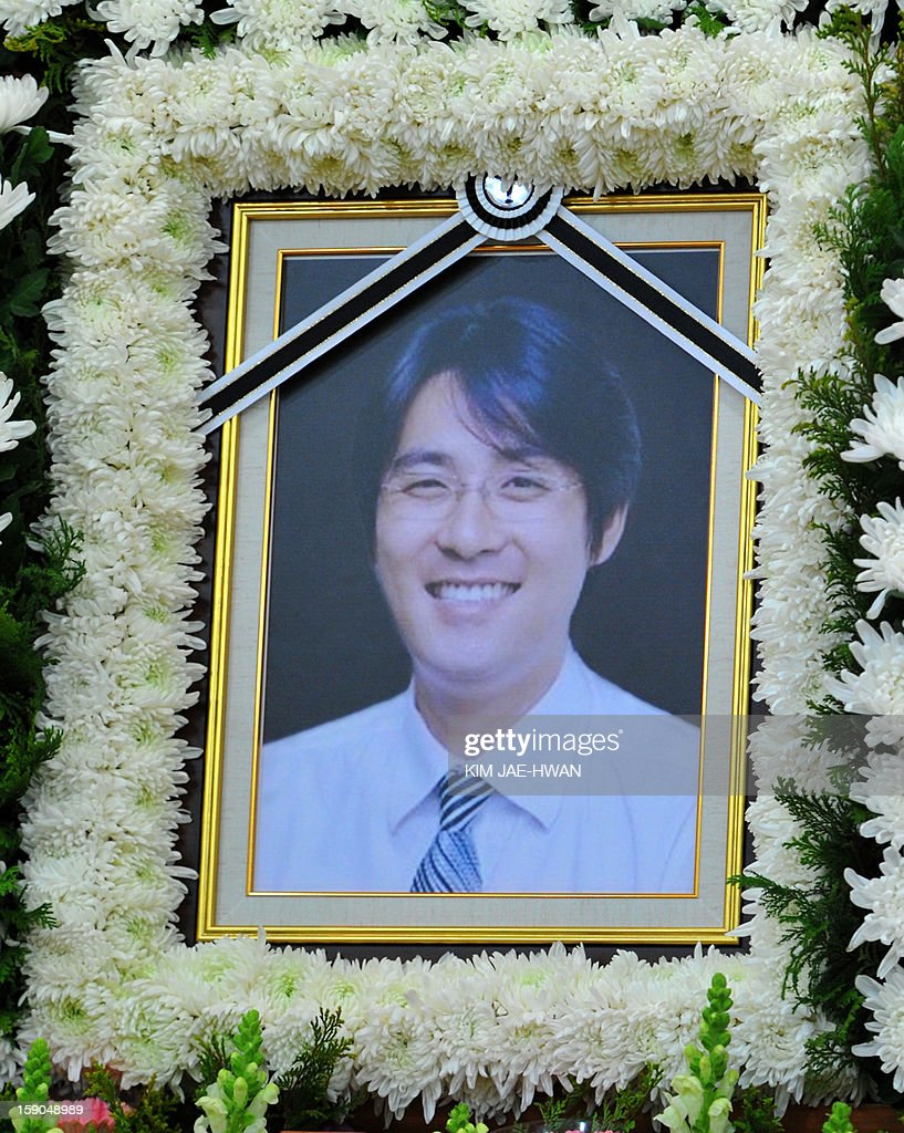 A portrait of Cho Sung-Min, a former South Korean pitcher for Japanese baseball team the Yomiuri Giants is displayed during his memorial service at a hospital in Seoul on January 7, 2013. Police confirmed on January 7 that a former baseball star and ex-husband of a top South Korean actress, whose 2008 suicide shocked the country, took his own life over the weekend.