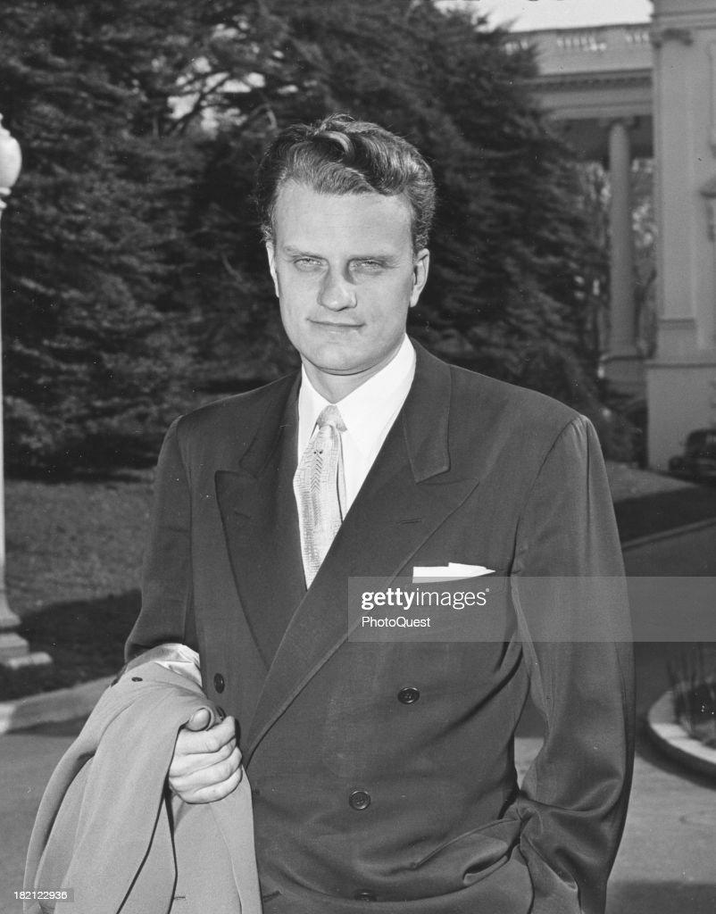 Portrait of Christian evangelical minister Billy Graham as he poses outside the White House Washington DC November 3 1953