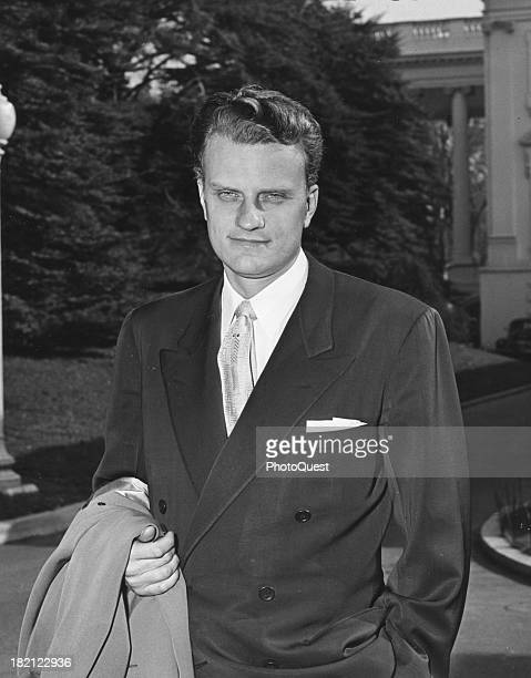 Portrait of Christian evangelical minister Billy Graham as he poses outside the White House Washington DC November 3 1953