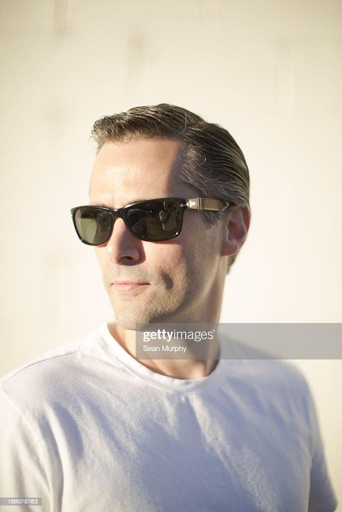 Portrait of classic man wearing sunglasses.