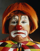 Portrait of clown looking sad, close-up of head