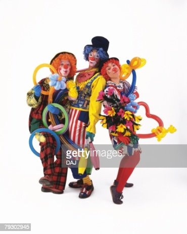 Portrait of Clowns Holding Balloon and Ring, Front View  : Stock Photo