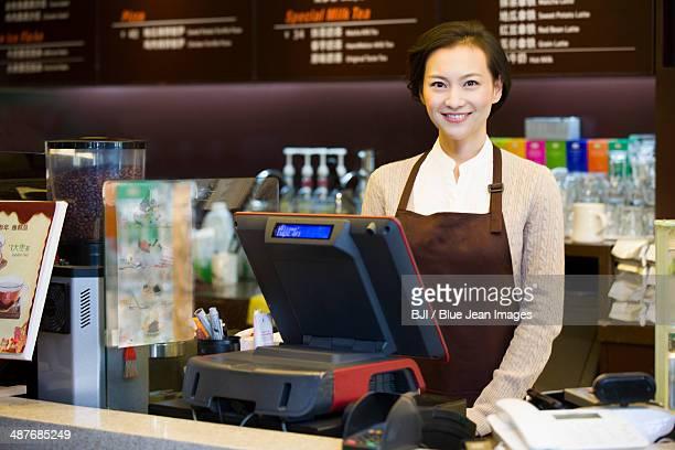 Portrait of coffee store waitress
