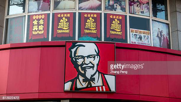 Portrait of Colonel Sanders hung on the exterior of a KFC restaurant On the early of February KFC China triumphs in Lawsuit Over Mutant Chicken...