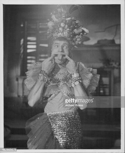 Portrait of comedian Jerry Lewis wearing a Carmen Miranda costume circa 1953