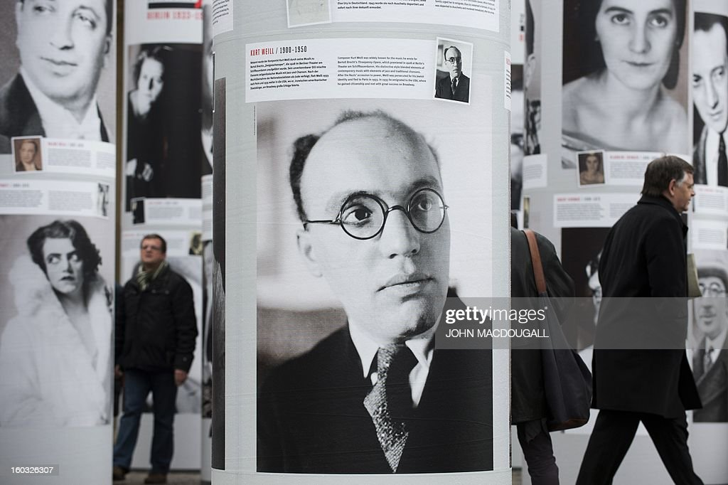 A portrait of composer Kurt Weill (C) appears in the 'Diversity Destroyed, Berlin 1933, 1938, 1945' outdoor exhibition in front of Berlin's Brandenburg Gate January 29, 2013. Featuring portraits of prominent members of the German capital's intellectual, artistic and cultural landscape who were affected by Nazi politics and terror, the exhibition coincides with the 80th anniversary of Adolf Hitler's accession to power January 30, 1933.