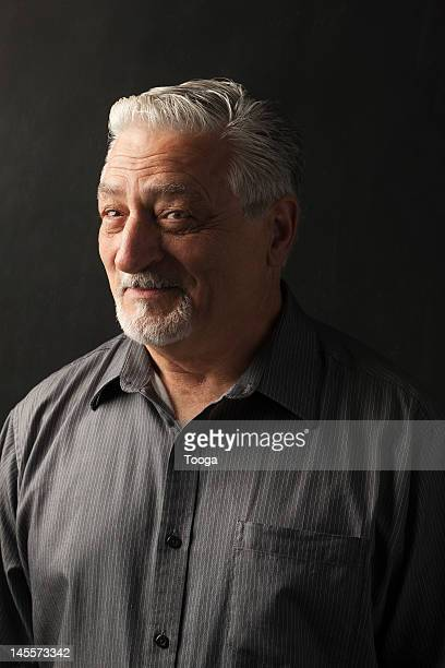 Portrait of confident and silver haired man