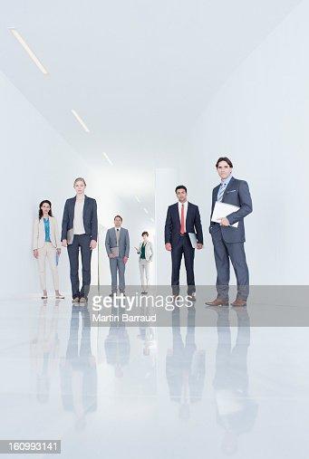 Portrait of confident business people in corridor