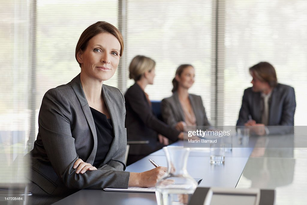 Portrait of confident businesswoman in conference room : Stock Photo