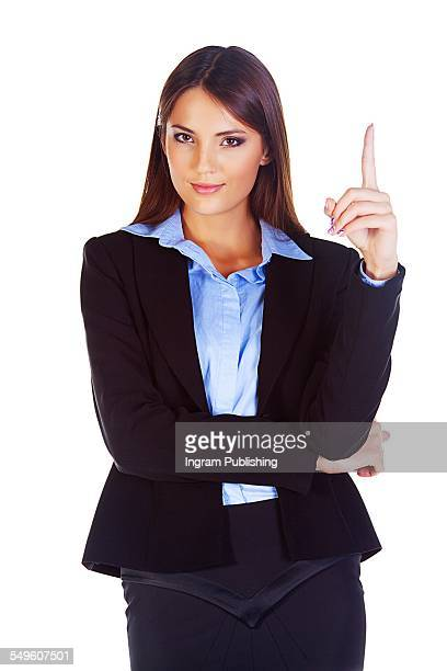 Portrait of confident businesswoman pointing