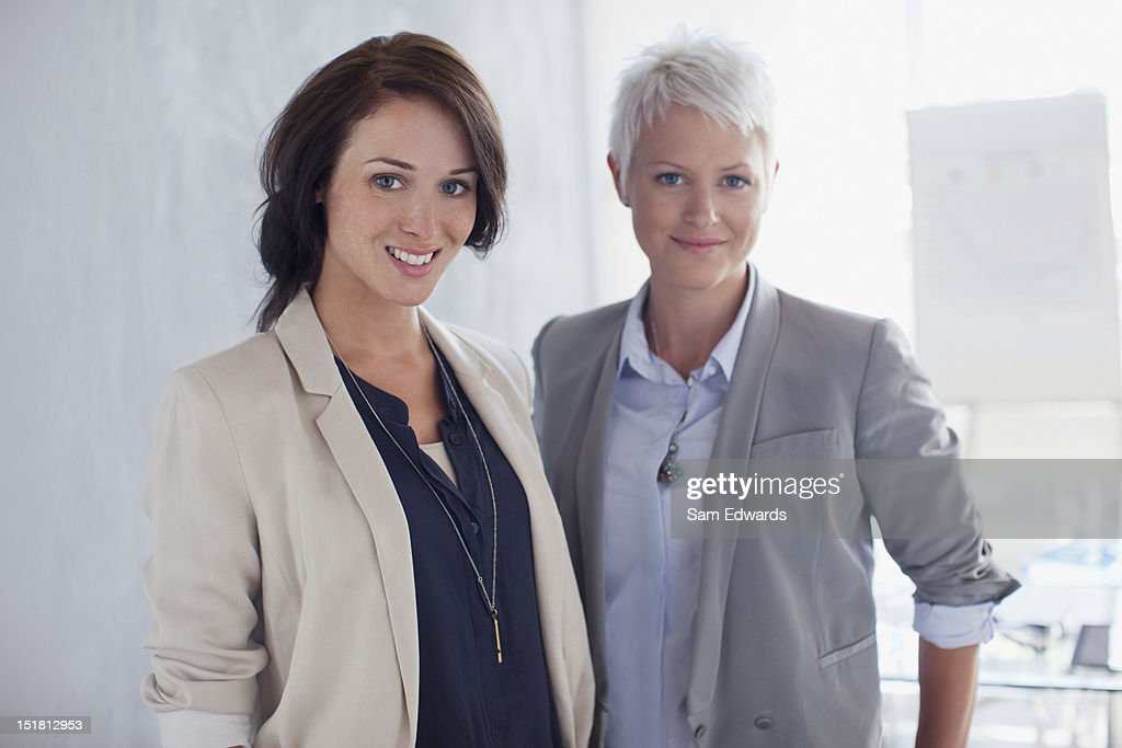 Portrait of confident businesswomen in office : Stock Photo