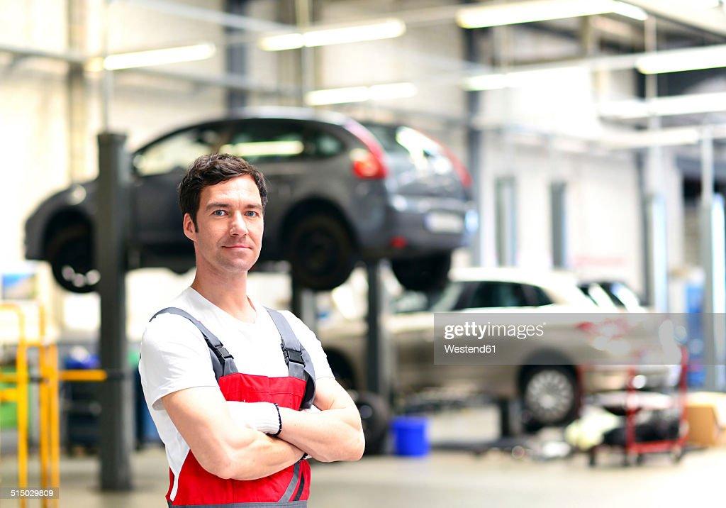 Portrait of confident car mechanic in a workshop